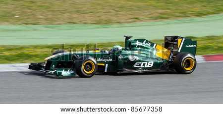 BARCELONA - FEBRUARY 18: Heikki Kovalainen of Lotus team driving his F1 car during Formula One Teams Test Days at Catalunya circuit, on February 18, 2011 in Barcelona, Spain.