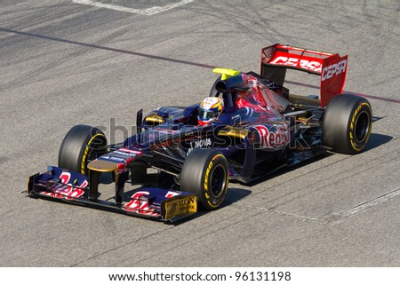 BARCELONA - FEBRUARY 21: Jean Eric Vergne of Toro Rosso F1 team racing during Formula One Teams Test Days at Catalunya circuit on February 21, 2012 in Barcelona, Spain. - stock photo
