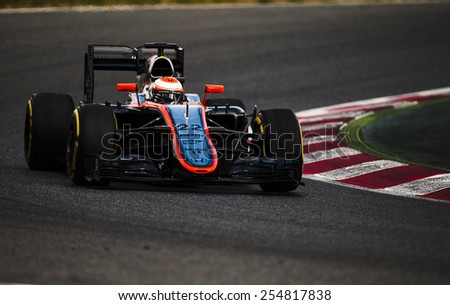 BARCELONA - FEBRUARY 21: Jenson Button of McLaren Honda at third day of Formula One Test Days at Catalunya Circuit on February 21, 2015 in Barcelona, Spain. - stock photo