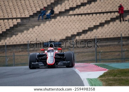 BARCELONA - FEBRUARY 21: Jenson Button of McLaren Honda F1 team at Formula One Test Days at Catalunya circuit on February 21, 2015 in Barcelona, Spain. - stock photo