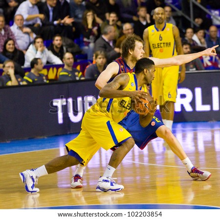 BARCELONA - FEBRUARY 29: Keith Langford (L) in action during the Euroleague basketball match between FC Barcelona and Maccabi Electra, final score 70-67, on February 29, 2012 in Barcelona, Spain. - stock photo
