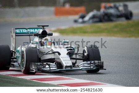 BARCELONA - FEBRUARY 21: Lewis Hamilton of Mercedes at third day of Formula One Test Days at Catalunya Circuit on February 21, 2015 in Barcelona, Spain. - stock photo
