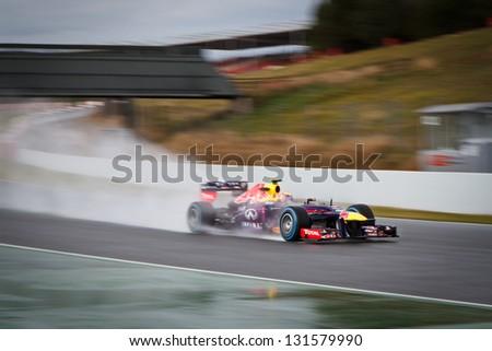 BARCELONA - FEBRUARY 28: Mark Webber of Infiniti Red Bull Racing F1 team during Formula One Test Days at Catalunya circuit on February 28, 2013 in Barcelona, Spain. - stock photo