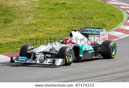 BARCELONA - FEBRUARY 18: Michael Schumacher of Mercedes team driving his F1 car during Formula One Teams Test Days at Catalunya circuit, on February 18, 2011 in Barcelona, Spain.