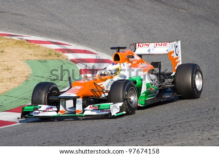 BARCELONA - FEBRUARY 24: Paul Di Resta of Force India F1 team racing at Formula One Teams Test Days at Catalunya circuit on February 24, 2012 in Barcelona, Spain. - stock photo
