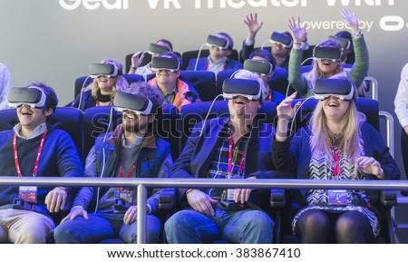 BARCELONA - FEBRUARY 24: people trying the new Samsung Gear VR a glasses mobile virtual reality device on the stand of the Mobile World Congress 2016 on February 24, 2016, Barcelona, Spain. - stock photo