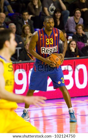 BARCELONA - FEBRUARY 29: Pete Mickeal in action during the Euroleague basketball match between FC Barcelona and Maccabi, final score 70-67, on February 29, 2012, in Palau Blaugrana, Barcelona, Spain.