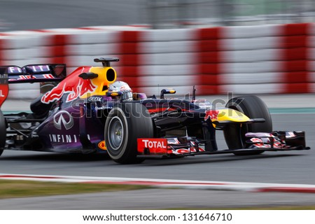 BARCELONA - FEBRUARY 19: Sebastian Vettel of Infiniti Red Bull Racing F1 team at Formula One Test Days at Catalunya circuit on February 19, 2013 in Barcelona, Spain. - stock photo