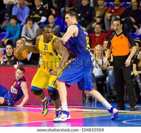 BARCELONA - FEBRUARY 29: Sofoklis Schortsanitis (L) in action at the Euroleague basketball match between FC Barcelona and Maccabi Electra, final score 70-67, on February 29, 2012, in Barcelona, Spain. - stock photo