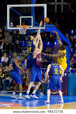 BARCELONA - FEBRUARY 29: Sofoklis Schortsanitis (R) in action during the Euroleague basketball match between FC Barcelona and Maccabi, final score 70-67, on February 29, 2012, in Barcelona, Spain. - stock photo