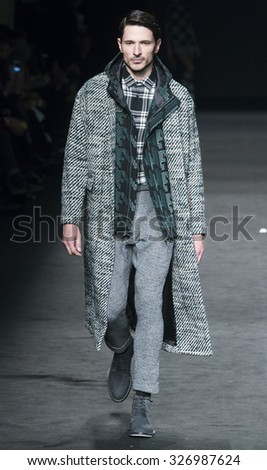 BARCELONA - FEBRUARY 04: spanish model Andres Velencoso walks on the Custo Barcelona catwalk during the 080 Barcelona Fashion runway Fall/Winter 2015 on February 04, 2015 in Barcelona, Spain.  - stock photo