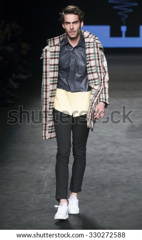 BARCELONA - FEBRUARY 02: spanish model Jon Kortajarena walks on the Pablo Erroz catwalk during the 080 Barcelona Fashion runway Fall/Winter 2015 on February 02, 2015 in Barcelona, Spain.  - stock photo