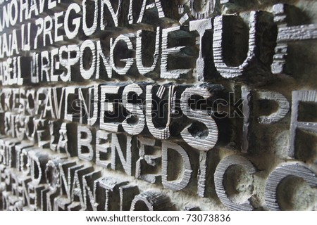 BARCELONA - FEBRUARY 18: The inscripted entrance door is printed with words from the Bible in various languages at the Sagrada Familia created by Gaudi on February 18, 2011 in Barcelona, Spain