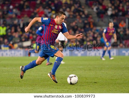 BARCELONA - FEBRUARY 2: Xavi Hernandez in action during the Spanish Cup match between FC Barcelona and Valencia CF, final score 2-0, on February 2, 2012, in Camp Nou stadium, Barcelona, Spain.