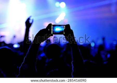 BARCELONA - JAN 29: A man takes a picture with his smartphone  in a concert at Razzmatazz venue on January 29, 2015 in Barcelona, Spain.