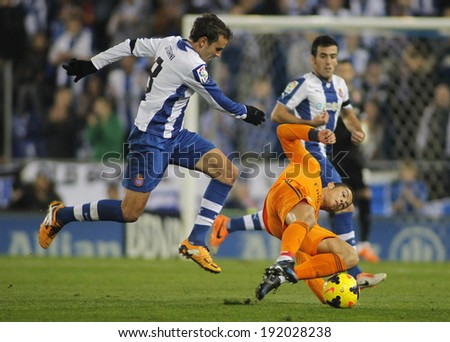 BARCELONA - JAN, 12: Cristiano Ronaldo(R) of Real Madrid vies with Stuani (L) of Espanyol  during the Spanish League match at the Estadi Cornella on January 12, 2014 in Barcelona, Spain - stock photo