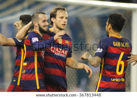 BARCELONA - JAN, 13: FC Barcelona players Aleix Vidal, Rakitic and Alves celebrating goal during a Spanish Cup match against RCD Espanyol at the Power8 stadium on January 13, 2016 in Barcelona, Spain - stock photo