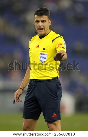 BARCELONA - JAN, 22: Referee Jesus Gil Manzano declaring a foul during a Spanish League match between Espanyol and Sevilla FC at the Estadi Cornella on January 22, 2015 in Barcelona, Spain - stock photo