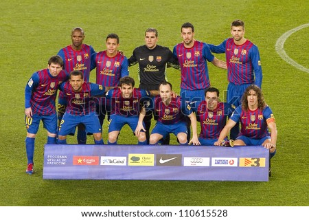 BARCELONA - JANUARY 25: Barcelona players lineup before the Spanish Cup match between FC Barcelona and Real Madrid, final score 2 - 2, on January 25, 2012, in Camp Nou, Barcelona, Spain. - stock photo