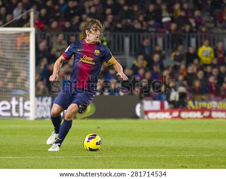 BARCELONA - JANUARY 27: Carles Puyol of FCB in action at the Spanish League match between FC Barcelona and Osasuna, final score 5 - 1, on January 27, 2013, in Barcelona, Spain. - stock photo