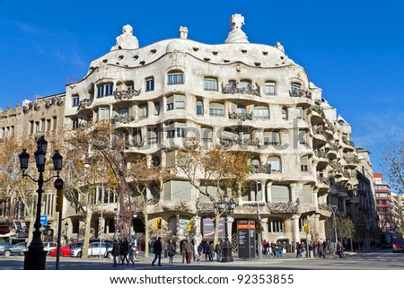 BARCELONA - JANUARY 7: Casa Mila, or La Pedrera, on January 7, 2012 in Barcelona, Spain. This famous building was designed by Antoni Gaudi - stock photo