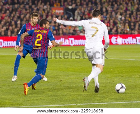 BARCELONA - JANUARY 25: Cristiano Ronaldo (7) in action at the Spanish Cup match between FC Barcelona and Real Madrid, final score 2 - 2, on January 25, 2012, in Camp Nou, Barcelona, Spain. - stock photo