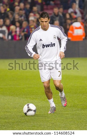 BARCELONA - JANUARY 25: Cristiano Ronaldo in action at the Spanish Cup match between FC Barcelona and Real Madrid, final score 2 - 2, on January 25, 2012, in Camp Nou, Barcelona, Spain. - stock photo