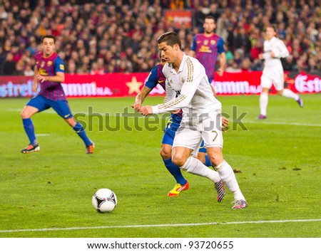 BARCELONA - JANUARY 25: Cristiano Ronaldo of Madrid in action during the Spanish Cup match between FC Barcelona and Real Madrid, final score 2 - 2, on January 25, 2012, in Camp Nou, Barcelona, Spain. - stock photo