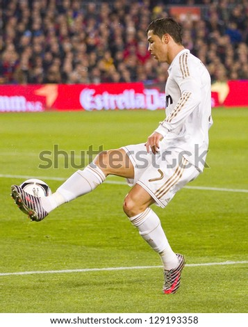 BARCELONA - JANUARY 25: Cristiano Ronaldo of RM in action at the Spanish Cup match between FC Barcelona and Real Madrid, final score 2 - 2, on January 25, 2012, in Barcelona, Spain. - stock photo