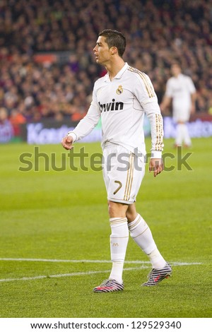 BARCELONA - JANUARY 25: Cristiano Ronaldo of RM in action at the Spanish Cup match between FC Barcelona and Real Madrid, final score 2 - 2, on January 25, 2012, in Barcelona, Spain.
