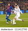 BARCELONA - JANUARY 25: Cristiano Ronaldo (R) of Madrid in action during the Spanish Cup match between FC Barcelona and Real Madrid, final score 2 - 2, on January 25, 2012, in Barcelona, Spain. - stock photo