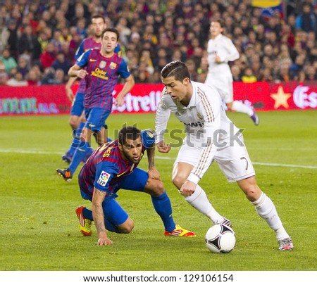 BARCELONA - JANUARY 25: Cristiano Ronaldo (R) of RM in action at the Spanish Cup match between FC Barcelona and Real Madrid, final score 2 - 2, on January 25, 2012, in Barcelona, Spain. - stock photo
