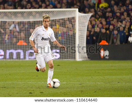 BARCELONA - JANUARY 25: Fabio Coentrao of Madrid in action during the Spanish Cup match between FC Barcelona and Real Madrid, final score 2 - 2, on January 25, 2012, in Barcelona, Spain. - stock photo