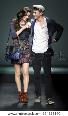 BARCELONA - JANUARY 29: French model Clement Chabernaud and an unknow girl model walking on the Desigual catwalk during the 080 Barcelona Fashion runway on January 29, 2013 in Barcelona, Spain.