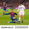 BARCELONA - JANUARY 25: Gerard Pique (L) and Ricardo Kaka in action during the Spanish Cup match between FC Barcelona and Real Madrid, final score 2 - 2, on January 25, 2012, in Barcelona, Spain. - stock photo