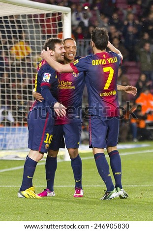 BARCELONA - JANUARY 27: Leo Messi and other players celebrating a goal at the Spanish League match between FC Barcelona and Osasuna, final score 5 - 1, on January 27, 2013, in Barcelona, Spain. - stock photo