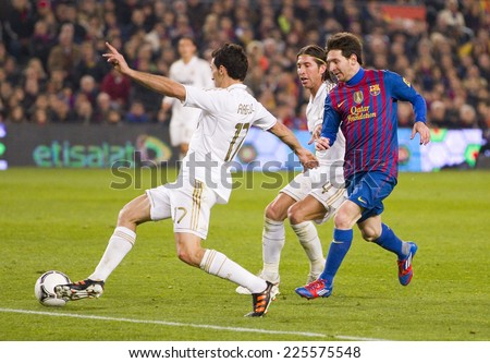 BARCELONA - JANUARY 25: Leo Messi (R) in action at the Spanish Cup match between FC Barcelona and Real Madrid, final score 2 - 2, on January 25, 2012, in Camp Nou, Barcelona, Spain. - stock photo