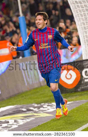 BARCELONA - JANUARY 4: Lionel Messi celebrating his goal at the Spanish Cup match between FC Barcelona and Osasuna, final score 4 - 0, on January 4, 2012 in Camp Nou stadium, Barcelona, Spain. - stock photo