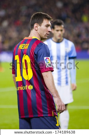 BARCELONA - JANUARY 26: Lionel Messi of FCB in action at Spanish league match between FC Barcelona and Malaga CF, final score 3-0, on January 26, 2014, in Barcelona, Spain. - stock photo