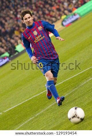 BARCELONA - JANUARY 25: Lionel Messi of FCB in action at the Spanish Cup match between FC Barcelona and Real Madrid, final score 2 - 2, on January 25, 2012, in Barcelona, Spain. - stock photo