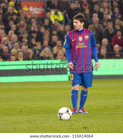 BARCELONA - JANUARY 25: Lionel Messi of FCB in action during the Spanish Cup match between FC Barcelona and Real Madrid, final score 2 - 2, on January 25, 2012, in Barcelona, Spain. - stock photo