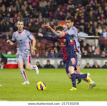 BARCELONA - JANUARY 27: Lionel Messi of FCB (middle) in action at the Spanish League match between FC Barcelona and Osasuna, final score 5 - 1, on January 27, 2013, in Barcelona, Spain. - stock photo
