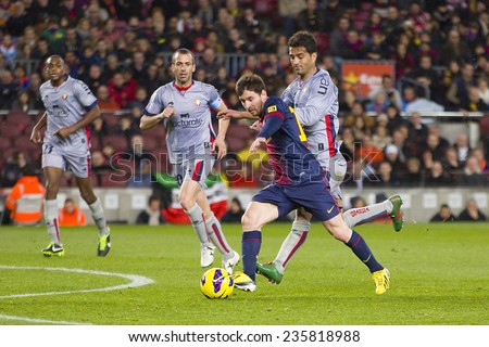 BARCELONA - JANUARY 27: Lionel Messi of FCB (middle) in action at the Spanish League match between FC Barcelona and Osasuna, final score 5 - 1, on January 27, 2013, in Barcelona, Spain.