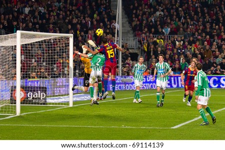 BARCELONA - JANUARY 12: Nou Camp football stadium, soccer Spanish Cup: FC Barcelona - Real Betis, 5 - 0. In the picture, Seydou Keita in action. January 12, 2011 in Barcelona (Spain). - stock photo