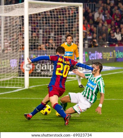 BARCELONA - JANUARY 12: Nou Camp soccer stadium, Spanish Cup match: FC Barcelona - Real Betis, 5 - 0. In the picture, Afellay in dribbling action. January 12, 2011 in Barcelona (Spain). - stock photo