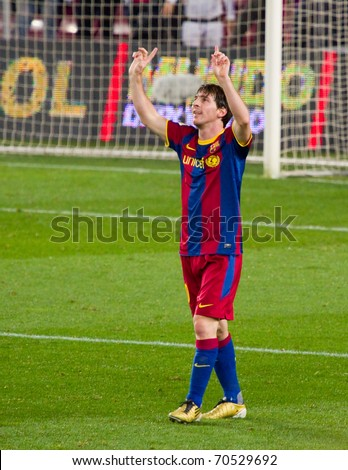 BARCELONA - JANUARY 12: Nou Camp stadium, soccer Spanish Cup match: FC Barcelona - Real Betis, 5 - 0. In the picture, Messi celebrating a goal. January 12, 2011 in Barcelona (Spain). - stock photo