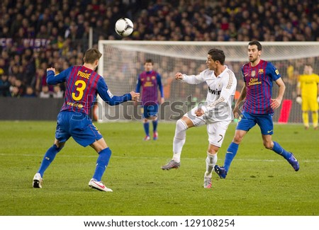 BARCELONA - JANUARY 25: Some players in action at the Spanish Cup match between FC Barcelona and Real Madrid, final score 2 - 2, on January 25, 2012, in Barcelona, Spain. - stock photo