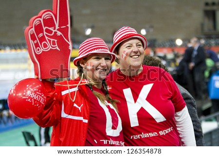 BARCELONA - JANUARY 25: Some unidentified Danish supporters at the Handball World Championship semi-final between Croatia and Denmark, final score 24-30, on January 25, 2013, in Barcelona, Spain. - stock photo