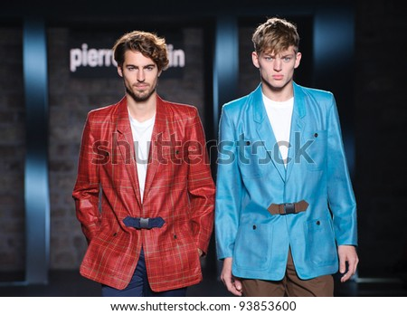 BARCELONA – JANUARY 28: Spanish model Antonio Navas (red jacket) on the Pierre Cardin catwalk during the 080 Barcelona Fashion runway on January 28, 2012 in Barcelona, Spain.