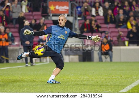 BARCELONA - JANUARY 4: Victor Valdes of FCB in action at the Spanish League match between FC Barcelona and Osasuna, final score 5 - 1, on January 27, 2013, in Barcelona, Spain. - stock photo